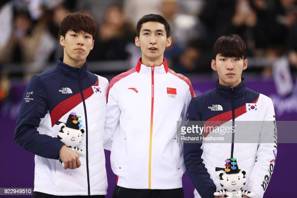 Silver medalist Daeheon Hwang of Korea gold medalist Dajing Wu of China and bronze medalist Hyojun Lim of Korea stand on the podium during the...
