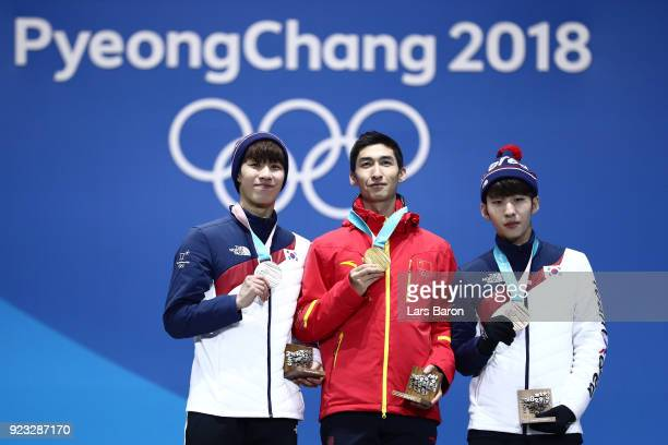 Silver medalist Daeheon Hwang of Korea gold medalist Dajing Wu of China and bronze medalist Hyojun Lim of Korea stand on the podium during the medal...