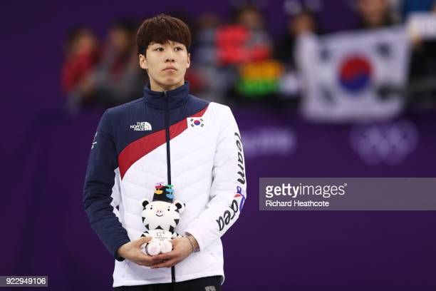 Silver medalist Daeheon Hwang of Korea stands on the podium during the victory ceremony after the Short Track Speed Skating Men's 500m Final on day...