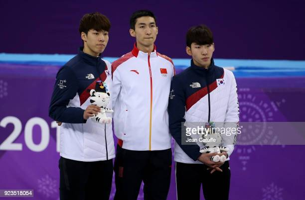 Silver medalist Daeheon Hwang of South Korea Gold medalist Dajing Wu of China and Bronze medalist Hyojun Lim of South Korea during ceremony following...