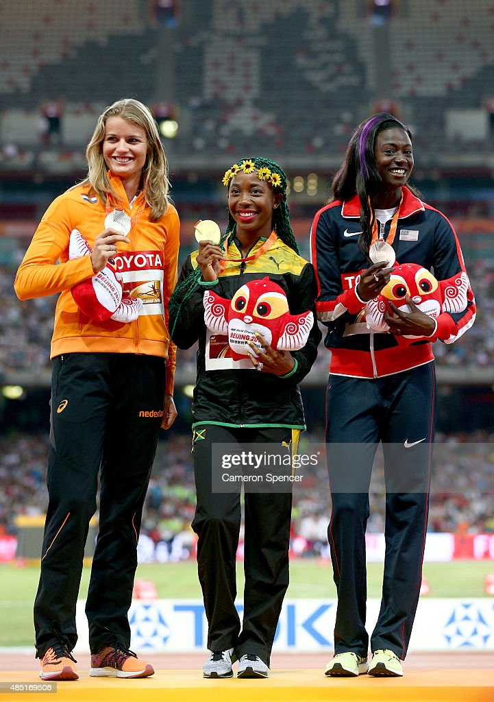 Silver medalist Dafne Schippers of the Netherlands, gold medalist Shelly-Ann Fraser-Pryce of Jamaica and bronze medalist Tori Bowie of the United States pose on the podium during the medal ceremony for the Women's 100 metres final during day four of the 15th IAAF World Athletics Championships Beijing 2015 at Beijing National Stadium on August 25, 2015 in Beijing, China.