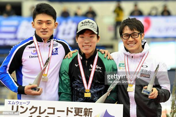 Silver medalist Daichi Yamanaka gold medalist Tsubasa Hasegawa and bronze medalist Joji Kato celebrate on the podium at the medal ceremony for the...