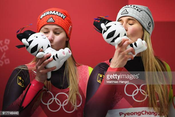 Silver medalist Dajana Eitberger of Germany and gold medalist Natalie Geisenberger of Germany celebrate following the Luge Women's Singles on day...