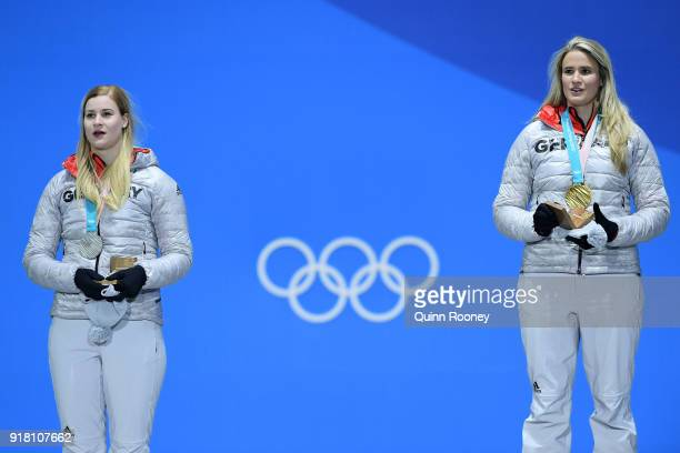 Silver medalist Dajana Eitberger of Germany and gold medalist Natalie Geisenberger of Germany pose during the medal ceremony for Luge Women's Singles...