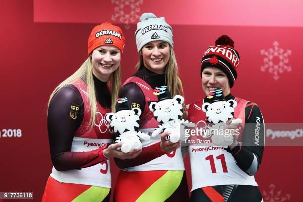Silver medalist Dajana Eitberger of Germany gold medalist Natalie Geisenberger of Germany and bronze medalist Alex Gough of Canada celebrate...