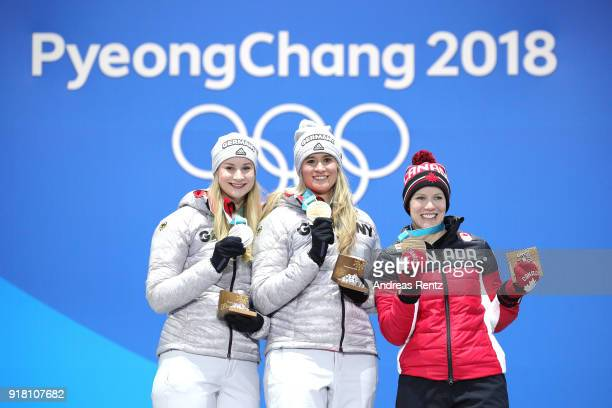 Silver medalist Dajana Eitberger of Germany gold medalist Natalie Geisenberger of Germany and bronze medalist Alex Gough of Canada pose during the...