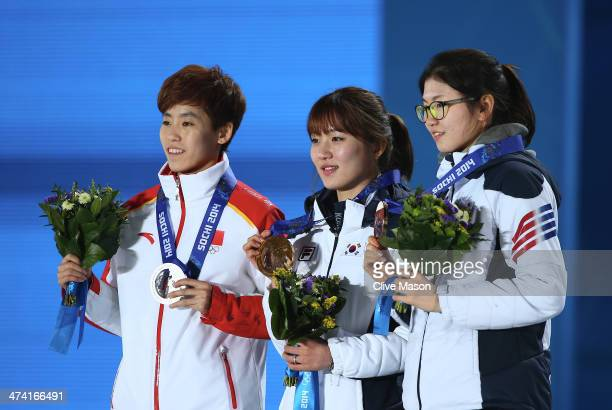Silver medalist Dajing Wu of China gold medalist Victor An of Russia and bronze medalist Charle Cournoyer of Canada celebrate on the podium during...