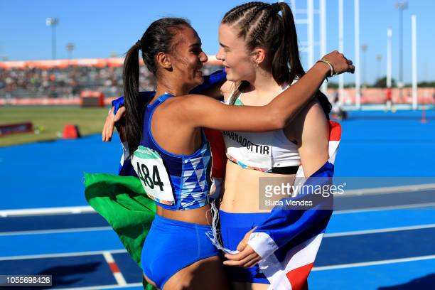Silver medalist Dalia Kaddari of Italy greats gold medalist Gudbjorg Jona Bjarnadottir of Iceland after competing in Women's 200m Stage 2 Heat 2...