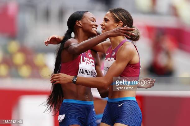 Silver medalist Dalilah Muhammad hugs gold medalist Sydney McLaughlin, both of Team United States, after competing in the Women's 400m Hurdles Final...