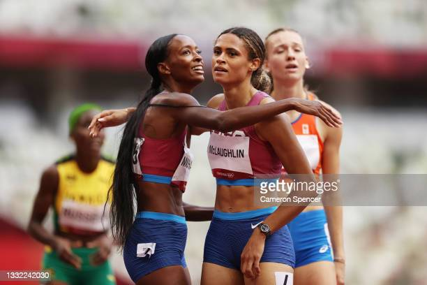 Silver medalist Dalilah Muhammad of Team United States and gold medalist Sydney McLaughlin of Team United States embrace following the Women's 400m...