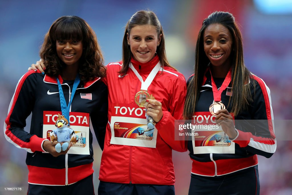 Silver medalist Dalilah Muhammad of the United States, gold medalist Zuzana Hejnova of the Czech Republic and bronze medalist Lashinda Demus of the United States pose on the podium during the medal ceremony for the Women's 400 metres hurdles during Day Seven of the 14th IAAF World Athletics Championships Moscow 2013 at Luzhniki Stadium at Luzhniki Stadium on August 16, 2013 in Moscow, Russia.