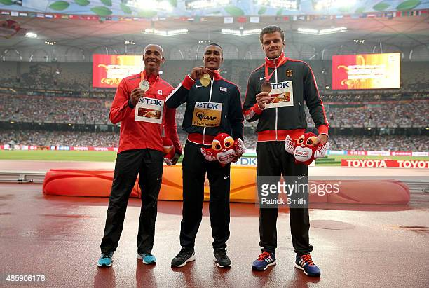 Silver medalist Damian Warner of Canada gold medalist Ashton Eaton of the United States and bronze medalist Rico Freimuth of Germany pose on the...