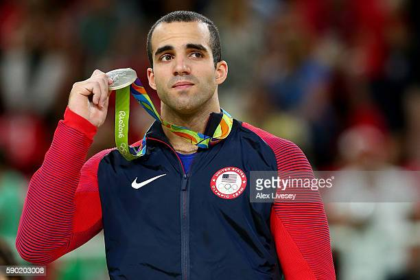 Silver medalist Danell Leyva of the United States celebrates on the podium at the medal ceremony for the Horizontal Bar on Day 11 of the Rio 2016...
