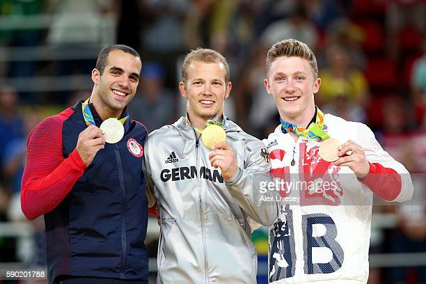 Silver medalist Danell Leyva of the United States, gold medalist Fabian Hambuechen of Germany and bronze medalist Nile Wilson of Great Britain pose...