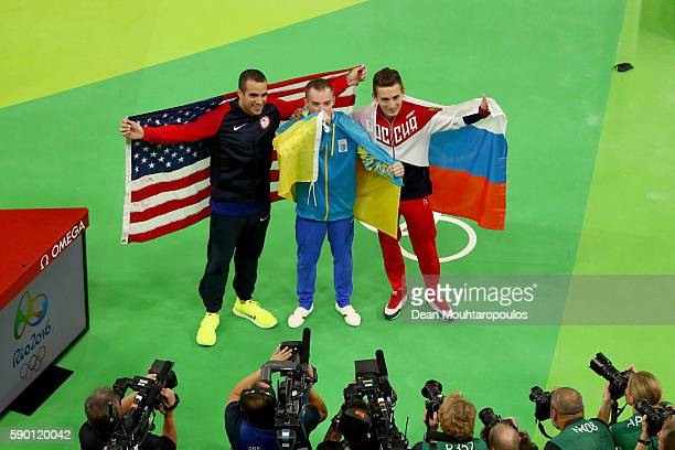 Silver medalist Danell Leyva of the United States gold medalist Oleg Verniaiev of Ukraine bronze medalist David Belyavskiy of Russia pose for...