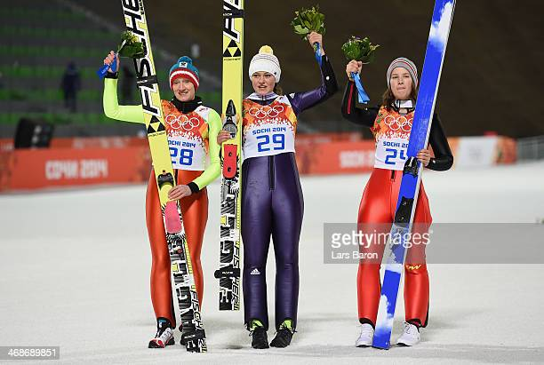 Silver medalist Daniela IraschkoStolz of Austria gold medalist Carina Vogt of Germany and bronze medalist Coline Mattel of France on the podium after...