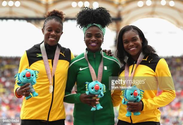Silver medalist Danielle Williams of Jamaica gold medalist Oluwatobiloba Amusan of Nigeria and bronze medalist Yanique Thompson of Jamaica pose...