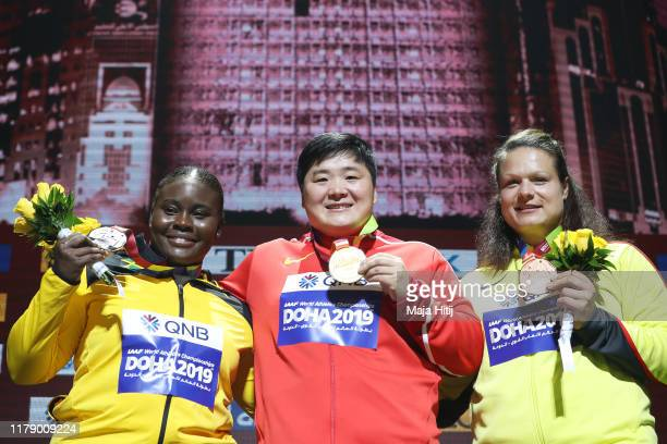 Silver medalist Danniel Thomas-Dodd of Jamaica, gold medalist Lijiao Gong of China and bronze medalist Christina Schwanitz of Germany stand on the...