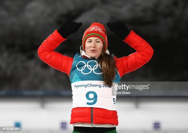 Silver medalist Darya Domracheva of Belarus celebrates during the victory ceremony for the Women's 125km Mass Start Biathlon on day eight of the...
