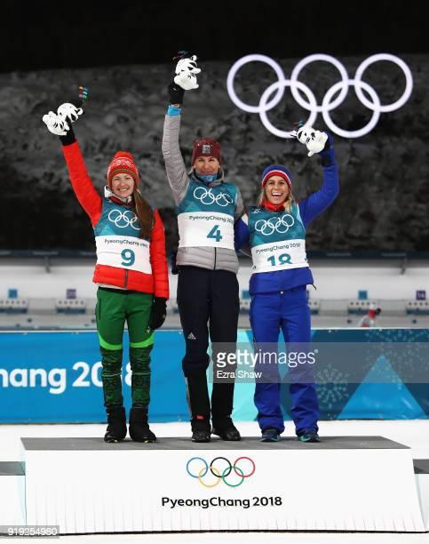 Silver medalist Darya Domracheva of Belarus gold medalist Anastasiya Kuzmina of Slovakia and bronze medalist Tiril Eckhoff of Norway celebrate on the...