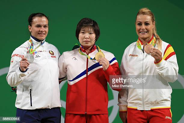 Silver medalist Darya Naumava of Belarus, Gold medalist Jong Sim Rim of North Korea and bronze medalist Lidia Valentin Perez of Spain pose on the...
