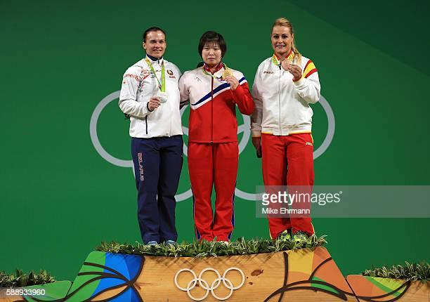 Silver medalist Darya Naumava of Belarus Gold medalist Jong Sim Rim of North Korea and bronze medalist Lidia Valentin Perez of Spain pose on the...
