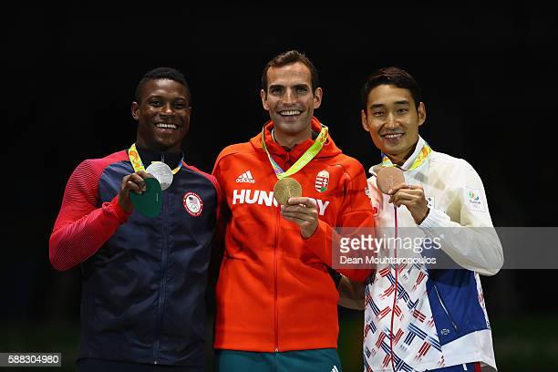 Silver medalist Daryl Homer of the United States gold medalist Aron Szilagyi of Hungary and bronze medalist Junghwan Kim of Korea pose on the podium...