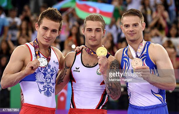 Silver medalist David Belyavskiy of Russia gold medalist Oleg Stepko of Azerbaijan and bronze medalist Marius Daniel Berbecar of Romania pose with...