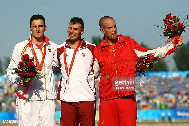 Silver medalist David Cal of Spain, gold medalist Attila Sandor Vajda of Hungary and bronze medalist Thomas Hall of Canada pose after the Canoe...
