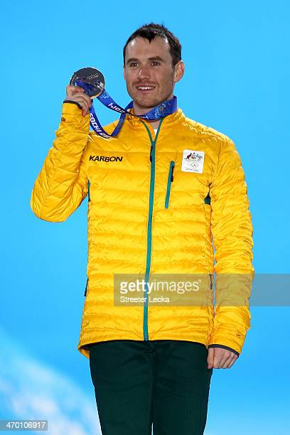Silver medalist David Morris of Australia celebrates on the podium during the medal ceremony for the Freestyle Skiing Men's Aerials Finals on day 11...