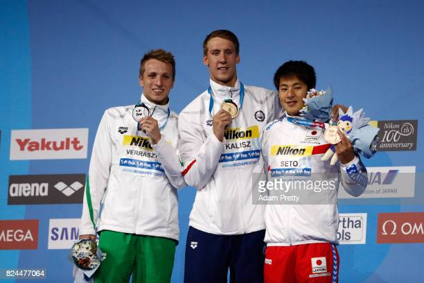 Silver medalist David Verraszto of Hungary gold medalist Chase Kalisz of the United States and bronze medalist Daiya Seto of Japan pose with the...