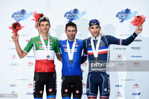Silver medalist Davide Formolo of Italy, gold medalist Diego Ulissi of Italy and bronze medalist Nans Peters of France pose during the medal ceremony...