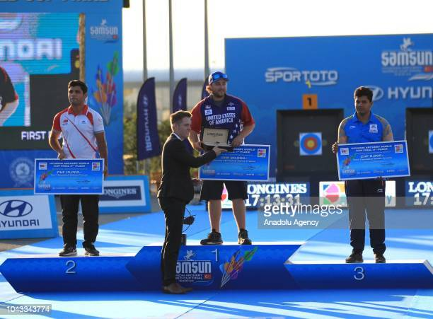 Silver medalist Demir Elmaagacli of Turkey gold medalist Kris Schaff of USA and bronze medalist Abhishek Verma of India receive their awards after...