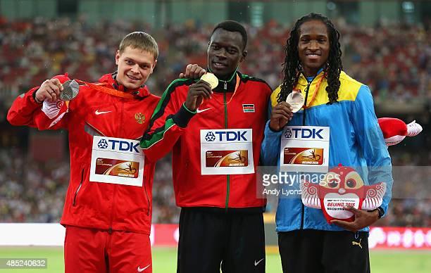 Silver medalist Denis Kudryavtsev of Russia gold medalist Nicholas Bett of Kenya and bronze medalist Jeffery Gibson of the Bahamas pose on the podium...