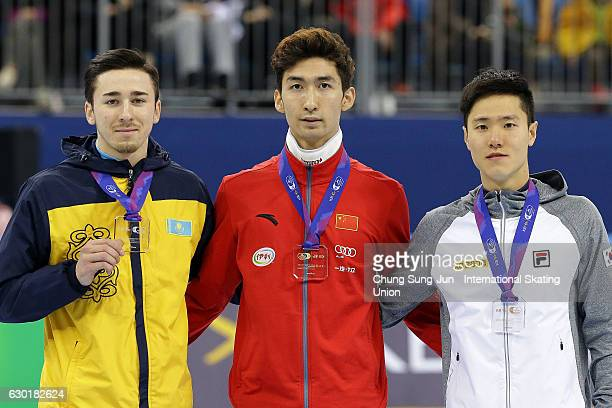 Silver medalist Denis Nikisha of Kazakhstan gold medalist Dajing Wu of China and bronze medalist Han SeungSoo of South Korea celebrate during the...