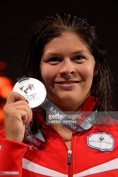 Silver medalist Denmark's Lotte Friis poses on the podium with her medal during the award ceremony of the women's 1500 m freestyle swimming event in...