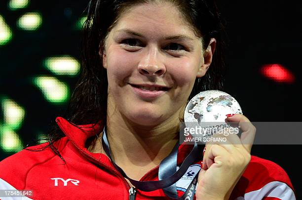 Silver medalist Denmark's Lotte Friis poses with her medal on the podium during the award ceremony of the women's 800metre freestyle swimming event...