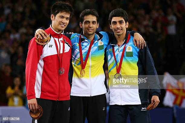 Silver medalist Derek Wong of Singapore gold medalist Kashyap Parupalli of India and bronze medalist RV Gurusaidutt of India pose in the medal...