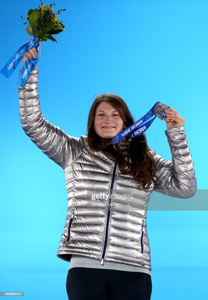 Silver medalist Devin Logan of the United States celebrates during the medal ceremony for the Freestyle Skiing Women's Ski Slopestyle on day 4 of the Sochi 2014 Winter Olympics at Medals Plaza on February 11, 2014 in Sochi, Russia.