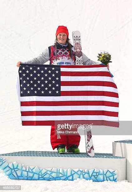 Silver medalist Devin Logan of the United States celebrates on the podium during the flower ceremony for the Freestyle Skiing Women's Ski Slopestyle...
