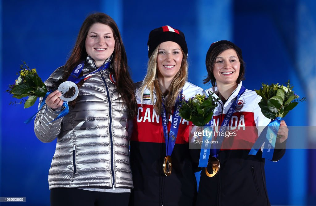 Silver medalist Devin Logan of the United States, gold medalist Dara Howell of Canada and bronze medalist Kim Lamarre of Canada celebrate on the podium during the medal ceremony for the for the Freestyle Skiing Women's Ski Slopestyle on day 4 of the Sochi 2014 Winter Olympics at Medals Plaza on February 11, 2014 in Sochi, Russia.