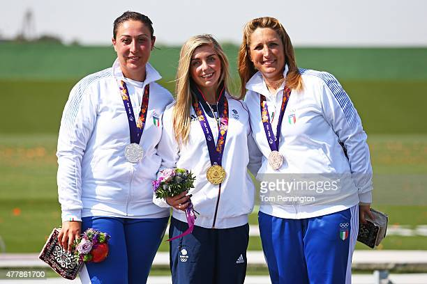 Silver medalist Diana Bacosi of Italy gold medalist Amber Hill of Great Britain and bronze medalist Chiara Cainero of Italy celebrate with the medals...