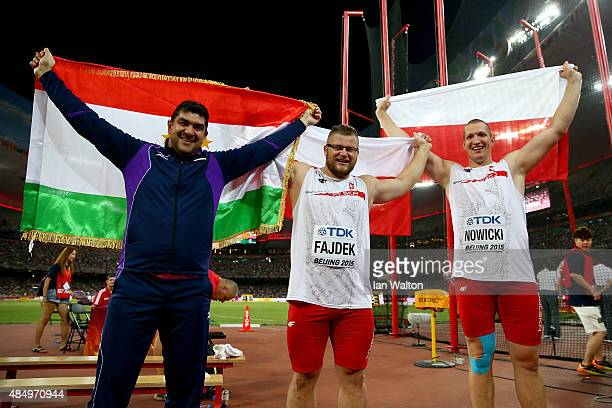 Silver medalist Dilshod Nazarov of Tajikistan gold medalist Pawel Fajdek of Poland and bronze medalist Wojciech Nowicki of Poland celebrate after the...