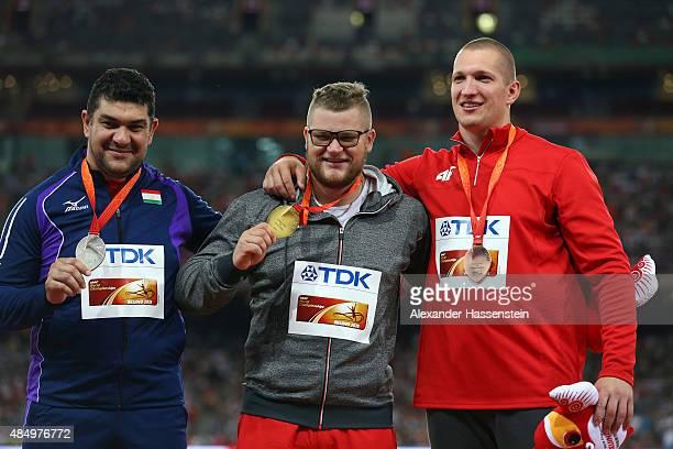 Silver medalist Dilshod Nazarov of Tajikistan gold medalist Pawel Fajdek of Poland and bronze medalist Wojciech Nowicki of Poland pose on the podium...