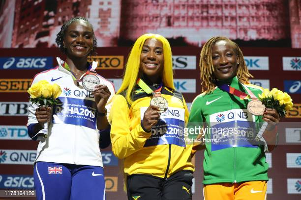 Silver medalist Dina AsherSmith of Great Britain gold medalist ShellyAnn FraserPryce of Jamaica and bronze medalist MarieJosée Ta Lou of the Ivory...
