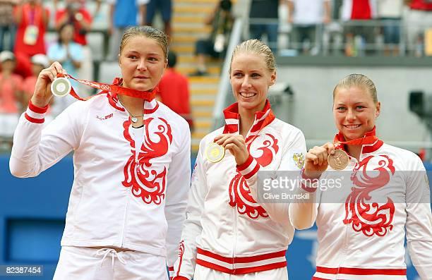 Silver medalist Dinara Safina of Russia, gold medalist Elena Dementieva of Russia and bronze medalist Vera Zvonareva pose together after receiving...