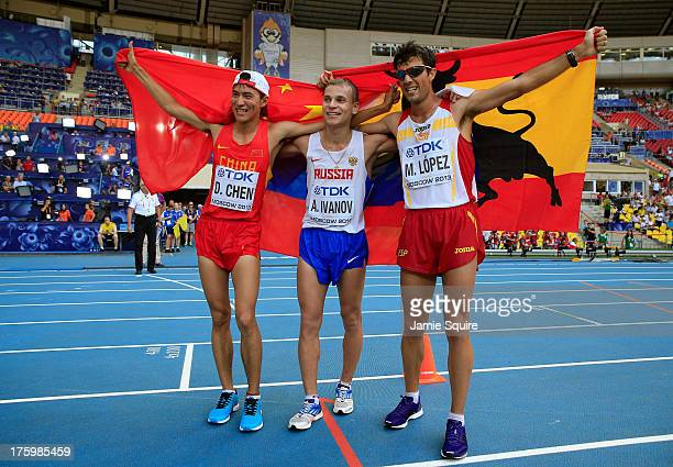 Silver medalist Ding Chen of China gold medalist Aleksandr Ivanov of Russia and bronze medalist Miguel angel Lopez pose after the Men's 20km Race...
