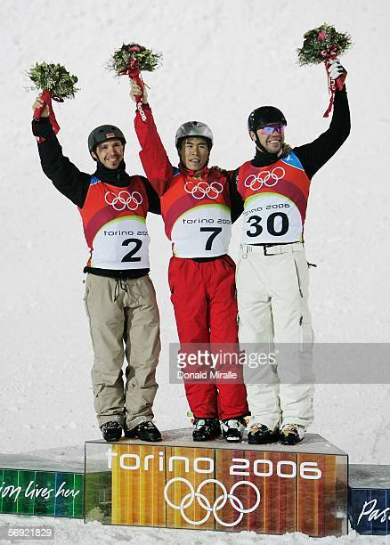 Silver medalist Dmitri Dashinski of Belarus gold medalist Xiaopeng Han of China and bronze medalist Vladimir Lebedev of Russia celebrate on the...
