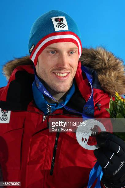 Silver medalist Dominik Landertinger of Austria celebrates during the medal ceremony for the Men's Sprint 10 km on day 2 of the Sochi 2014 Winter...