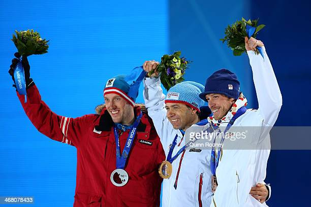 Silver medalist Dominik Landertinger of Austria gold medalist Ole Einar Bjoerndalen of Norway and bronze medalist Jaroslav Soukup of the Czech...